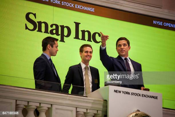 Bobby Murphy cofounder and chief technology officer at Snap Inc from left Evan Spiegel cofounder and chief executive officer of Snap Inc ring the...