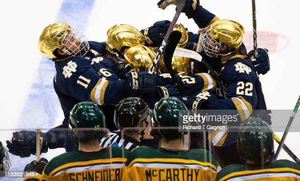 Bobby Nardella of the Notre Dame Fighting Irish celebrates with his teammates Andrew Peeke Cam Morrison and Cal Burke after he scored a goal against...