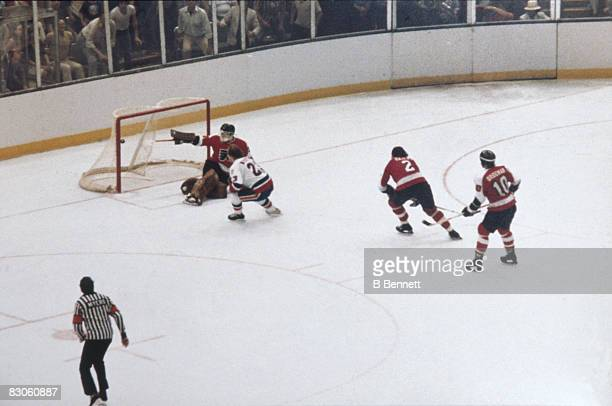Bobby Nystrom of the New York Islanders scores the overtime goal past goalie Pete Peeters of the Philadelphia Flyers to win Game 6 of the 1980...