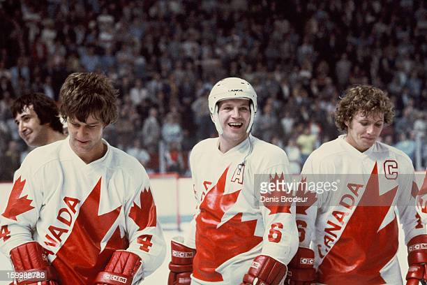 Bobby Orr Denis Potvin and Bobby Clarke of team Canada celebrate a win against Czechoslovakia after the Canada Cup Final held at the Montreal Forum...