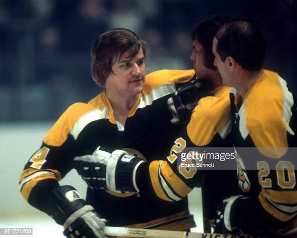 Bobby Orr Don Awrey and Dallas Smith of the Boston Bruins celebrate on the ice during an NHL game against the New York Rangers circa 1973 at the...