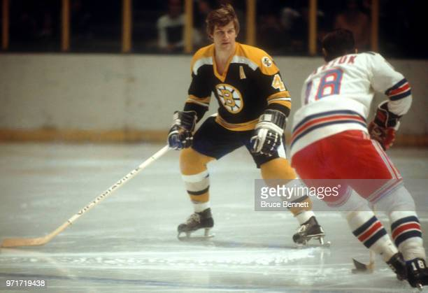Bobby Orr of the Boston Bruins defends against Walt Tkaczuk of the New York Rangers during an NHL game circa 1972 at the Madison Square Garden in New...