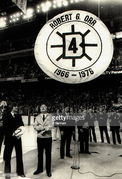 Bobby Orr of the Boston Bruins has his number retired during his retirement ceremony at the Boston Gardens on January 9 1979 in Boston Massachusetts...