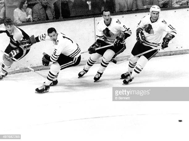 Bobby Orr of the Boston Bruins is defended by Eric Nesterenko Bill White and Doug Mohns of the Chicago Blackhawks during Game 3 of the 1970...