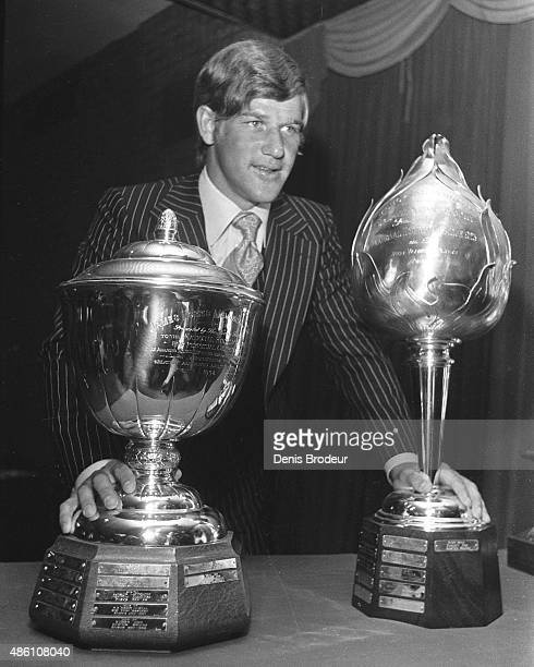 Bobby Orr of the Boston Bruins poses for a photo with the the James Norris Memorial Trophy and the Hart Memorial Trophy after being selected as the...