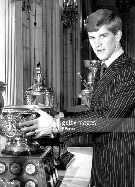Bobby Orr of the Boston Bruins poses with the Hart Norris and Art Ross Trophies after winning them for the regular season on May 8 1970 in Boston...