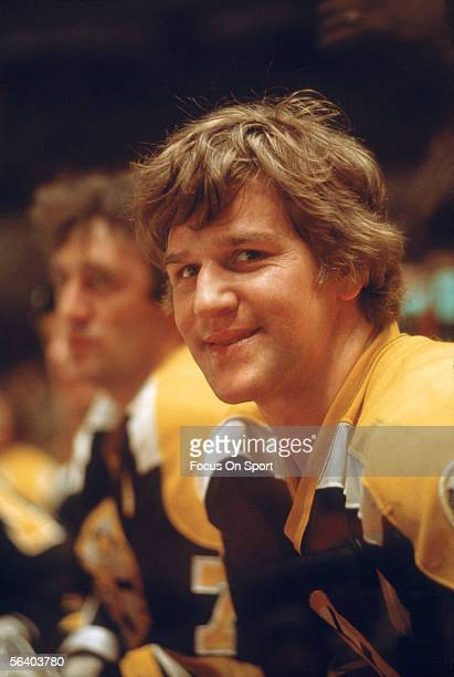 Bobby Orr of the Boston Bruins smiles at the camera from the players' bench circa the 1970's during a game