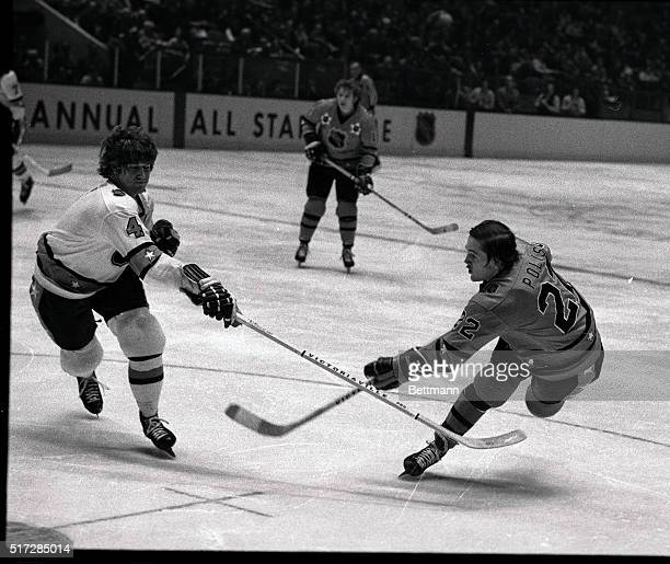 Bobby Orr tries to stop a shot on goal by Greg Polis during tonight's NHL AllStar game