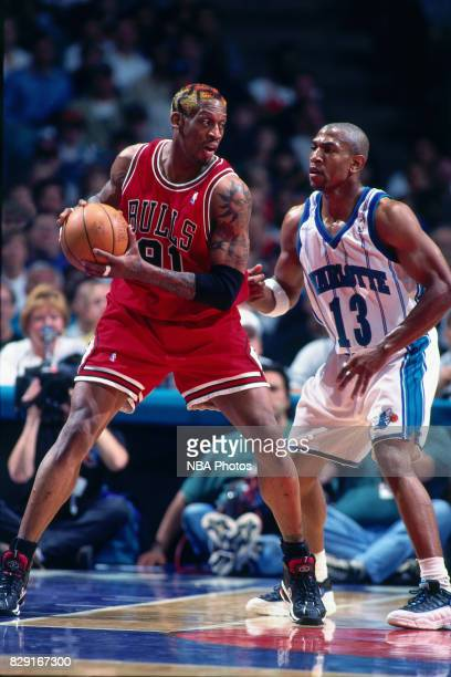 Bobby Phills of the Charlotte Hornets guards Dennis Rodman of the Chicago Bulls at the Charlotte Coliseum in Charlotte North Carolina circa 1998 NOTE...