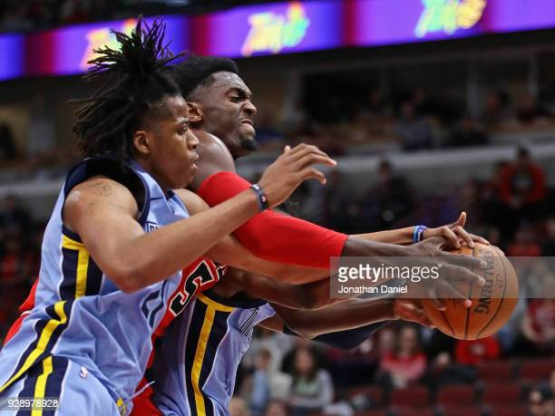 Bobby Portis of the Chicago Bulls battle for the ball with Deyonta Davis and Kobi Simmons of the Memphis Grizzlies at the United Center on March 7...