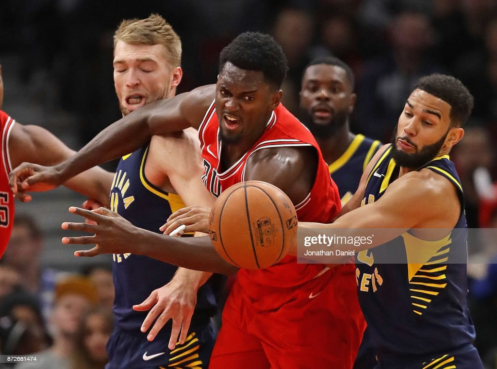 Bobby Portis #5 of the Chicago Bulls battles for a loose ball with Domantas Sabonis #11 (L) and Cory Joseph #6 of the Indiana Pacers at the United Center on November 10, 2017 in Chicago, Illinois.