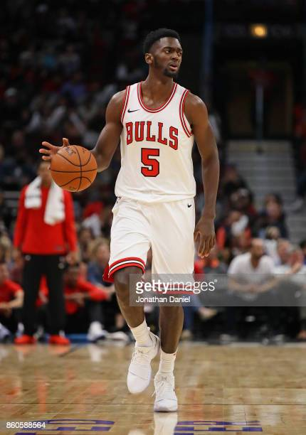 Bobby Portis of the Chicago Bulls brings the ball up the court against the New Orleans Pelicans during a preseason game at the United Center on...