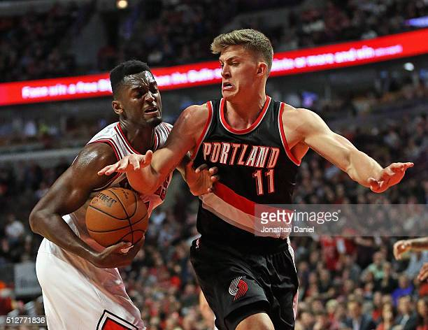 Bobby Portis of the Chicago Bulls drives against Meyers Leonard of the Portland Trail Blazers at the United Center on February 27 2016 in Chicago...