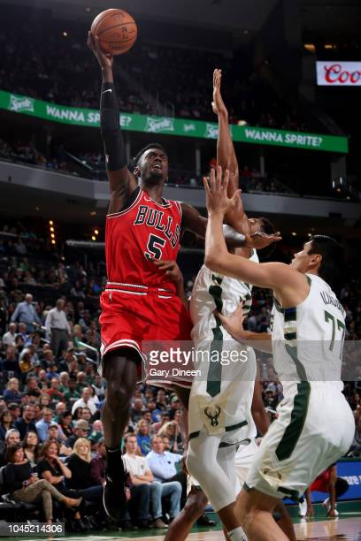 Bobby Portis of the Chicago Bulls drives to the basket against the Milwaukee Bucks during a preseason game on October 3 2018 at Fiserv Forum in...