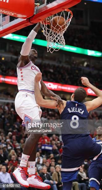 Bobby Portis of the Chicago Bulls dunks over Nemanja Bjelica of the Minnesota Timberwolves at the United Center on February 9 2018 in Chicago...
