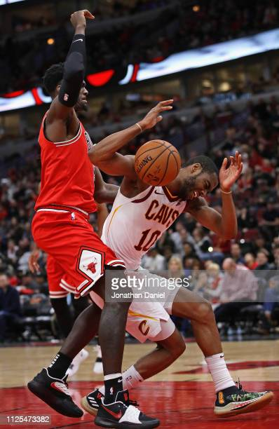 Bobby Portis of the Chicago Bulls fouls Alec Burks of the Cleveland Cavaliers at the United Center on January 27 2019 in Chicago Illinois NOTE TO...