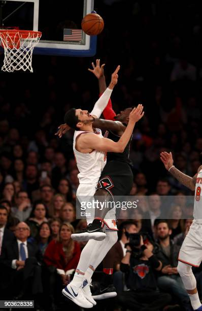 Bobby Portis of the Chicago Bulls fouls Enes Kanter of the New York Knicks in the second half at Madison Square Garden on January 10 2018 in New York...