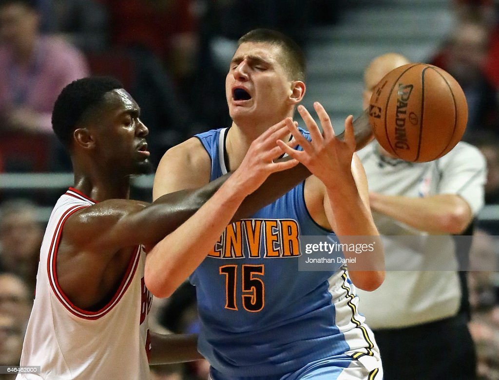 Bobby Portis #5 of the Chicago Bulls fouls Nikola Jokic #15 of the Denver Nuggets at the United Center on February 28, 2017 in Chicago, Illinois. The Nuggets defeated the Bulls 125-107.