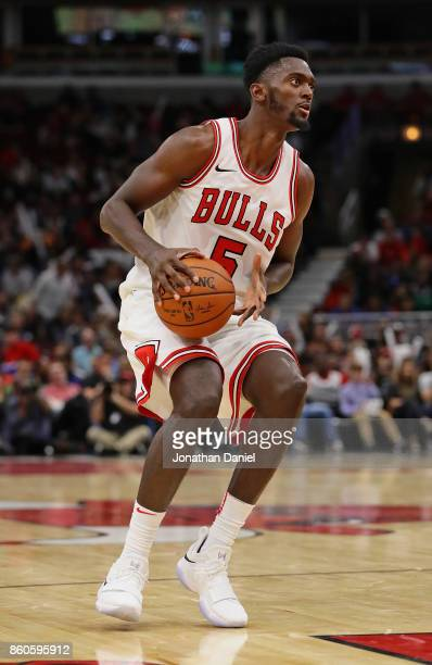 Bobby Portis of the Chicago Bulls looks to pass against the New Orleans Pelicans during a preseason game at the United Center on October 8 2017 in...
