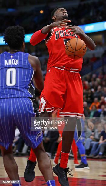 Bobby Portis of the Chicago Bulls looses control of the ball under pressure from Jamel Artis of the Orlando Magic at the United Center on December 20...