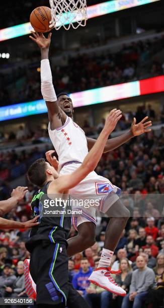Bobby Portis of the Chicago Bulls puts up a shot over Doug McDermott of the Dallas Mavericks at the United Center on March 2 2018 in Chicago Illinois...