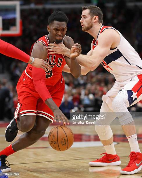 Bobby Portis of the Chicago Bulls s fouled by Jason Smith of the Washington Wizards at the United Center on February 10 2018 in Chicago Illinois The...