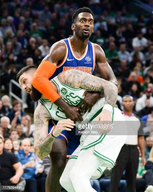Bobby Portis of the New York Knicks holds onto Vincent Poirier of the Boston Celtics in the second half at TD Garden on November 1, 2019 in Boston,...