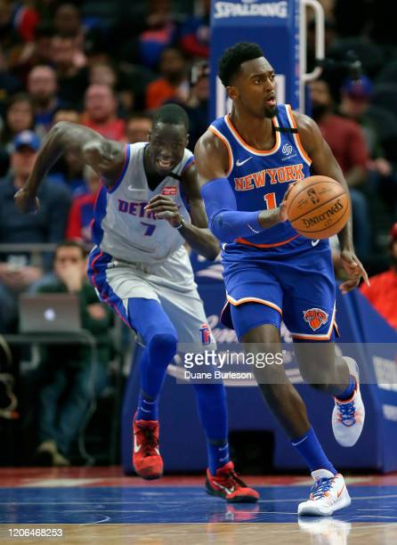 Bobby Portis of the New York Knicks is pursued down court by Thon Maker of the Detroit Pistons during the first half at Little Caesars Arena on...