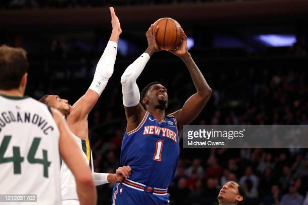 Bobby Portis of the New York Knicks takes a shot against Rudy Gobert of the Utah Jazz during their game at Madison Square Garden on March 04 2020 in...