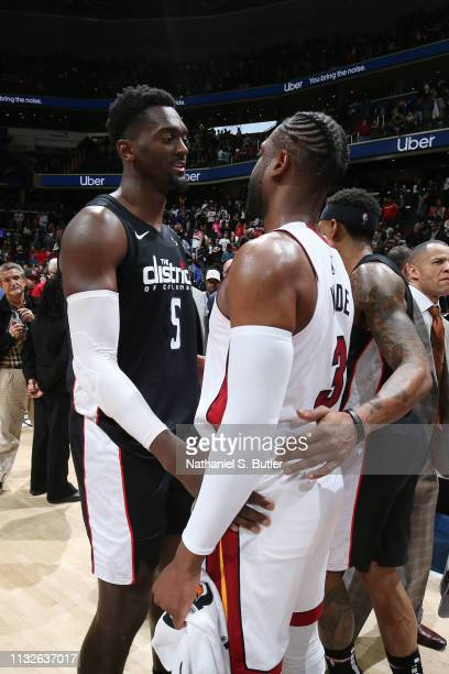 Bobby Portis of the Washington Wizards and Dwyane Wade of the Miami Heat hug after the game against the Washington Wizards on March 23 2019 at...