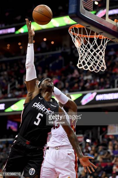 Bobby Portis of the Washington Wizards shoots in front of Bam Adebayo of the Miami Heat during the second half at Capital One Arena on March 23 2019...
