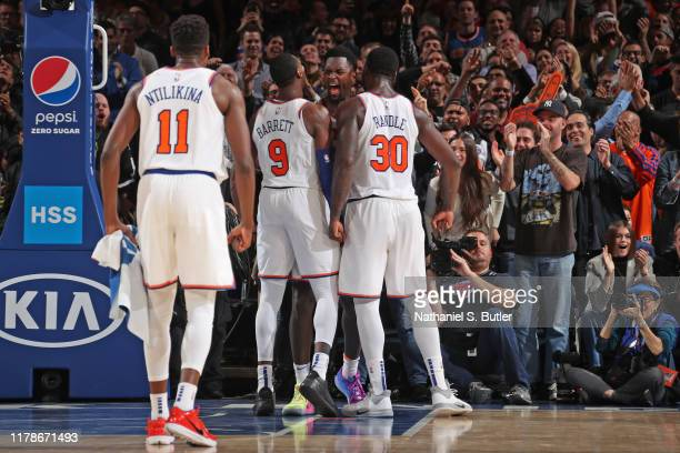Bobby Portis, RJ Barrett and Julius Randle of the New York Knicks yell and celebrates against the Chicago Bulls on October 28, 2019 at Madison Square...