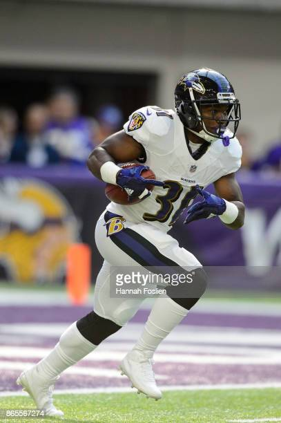 Bobby Rainey of the Baltimore Ravens returns a kick against the Minnesota Vikings during the game on October 22 2017 at US Bank Stadium in...
