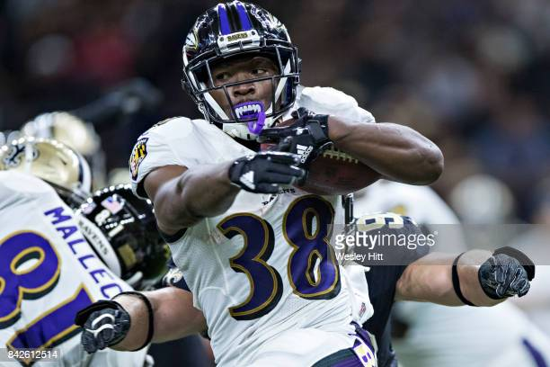 Bobby Rainey of the Baltimore Ravens runs the ball during a preseason game against the New Orleans Saints at MercedesBenz Superdome on August 31 2017...