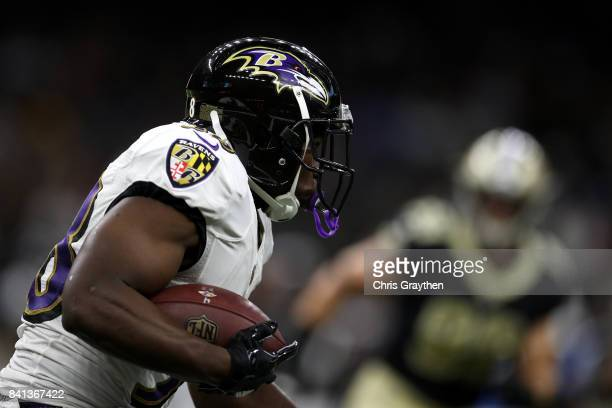 Bobby Rainey of the Baltimore Ravens runs with the ball against the New Orleans Saints at MercedesBenz Superdome on August 31 2017 in New Orleans...