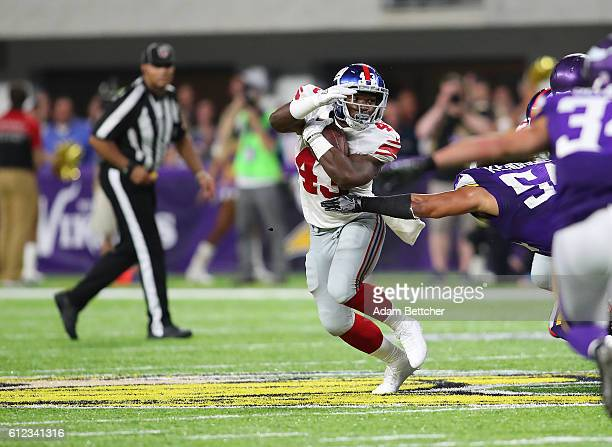Bobby Rainey of the New York Giants avoids a tackle in the second half of the game against the Minnesota Vikings on October 3 2016 at US Bank Stadium...