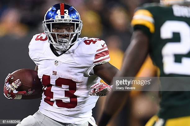 Bobby Rainey of the New York Giants runs for yards during a game against the Green Bay Packers at Lambeau Field on October 9 2016 in Green Bay...