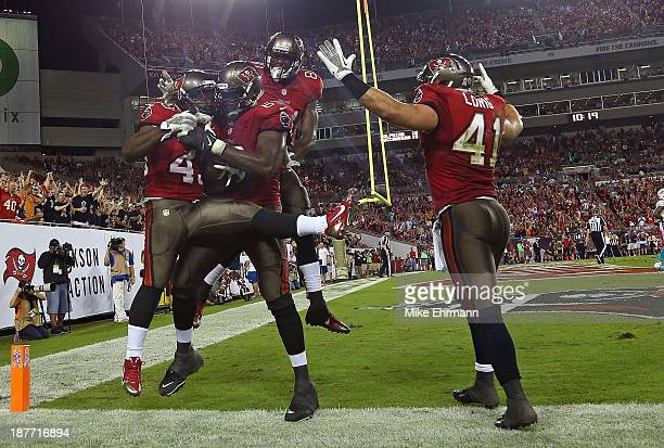 Bobby Rainey of the Tampa Bay Buccaneers celebrates a touchdown during a game against the Miami Dolphins at Raymond James Stadium on November 11 2013...