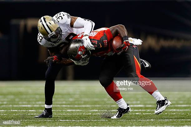 Bobby Rainey of the Tampa Bay Buccaneers is brought down by Brandon Browner of the New Orleans Saints during the second quarter of a game at the...