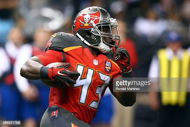 Bobby Rainey of the Tampa Bay Buccaneers runs for yards during the third quarter of a game against the New Orleans Saints at the MercedesBenz...