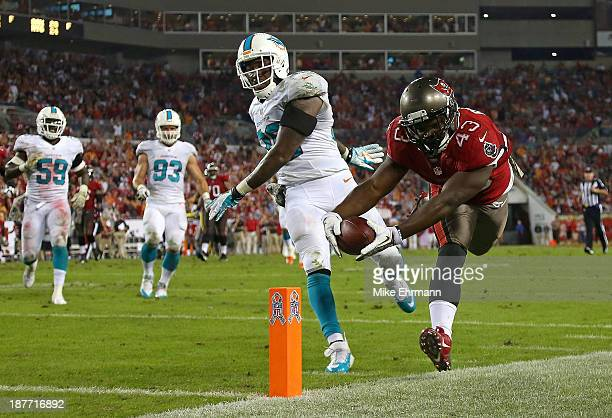 Bobby Rainey of the Tampa Bay Buccaneers scores a touchdown during a game against the Miami Dolphins at Raymond James Stadium on November 11 2013 in...