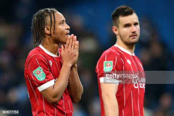 Bobby Reid and Bailey Wright of Bristol City look dejected in defeat after the Carabao Cup SemiFinal First Leg match between Manchester City and...