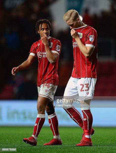 Bobby Reid and Hordur Magnusson of Bristol City cut dejected figures at the final whistle during the Sky Bet Championship match between Bristol City...