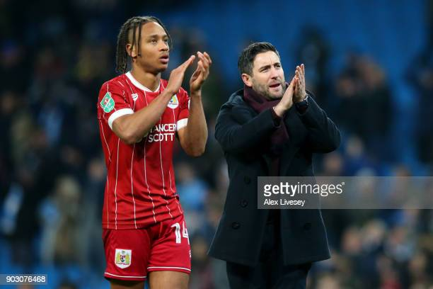 Bobby Reid of Bristol City and Lee Johnson manager of Bristol City look dejected in defeat after the Carabao Cup SemiFinal First Leg match between...