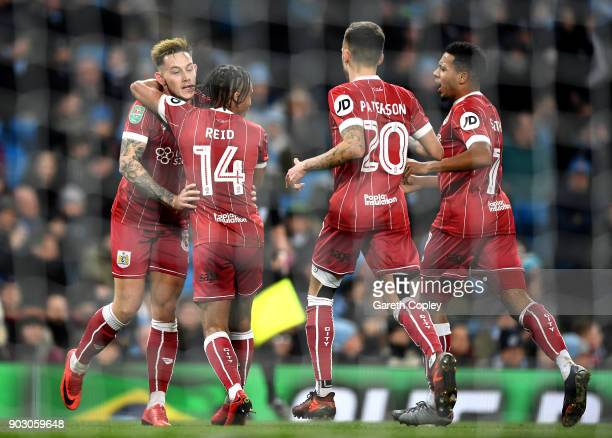 Bobby Reid of Bristol City celebrates as he scores their first goal from the penalty spot with team mates during the Carabao Cup SemiFinal First Leg...