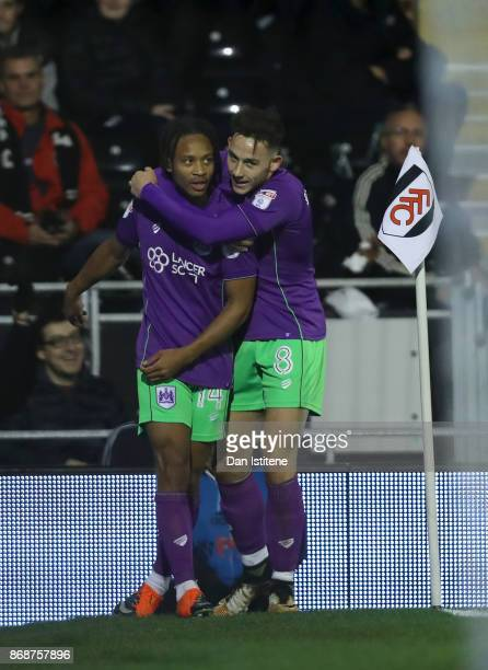 Bobby Reid of Bristol City celebrates with teammate Josh Brownhill after scoring the opening goal during the Sky Bet Championship match between...