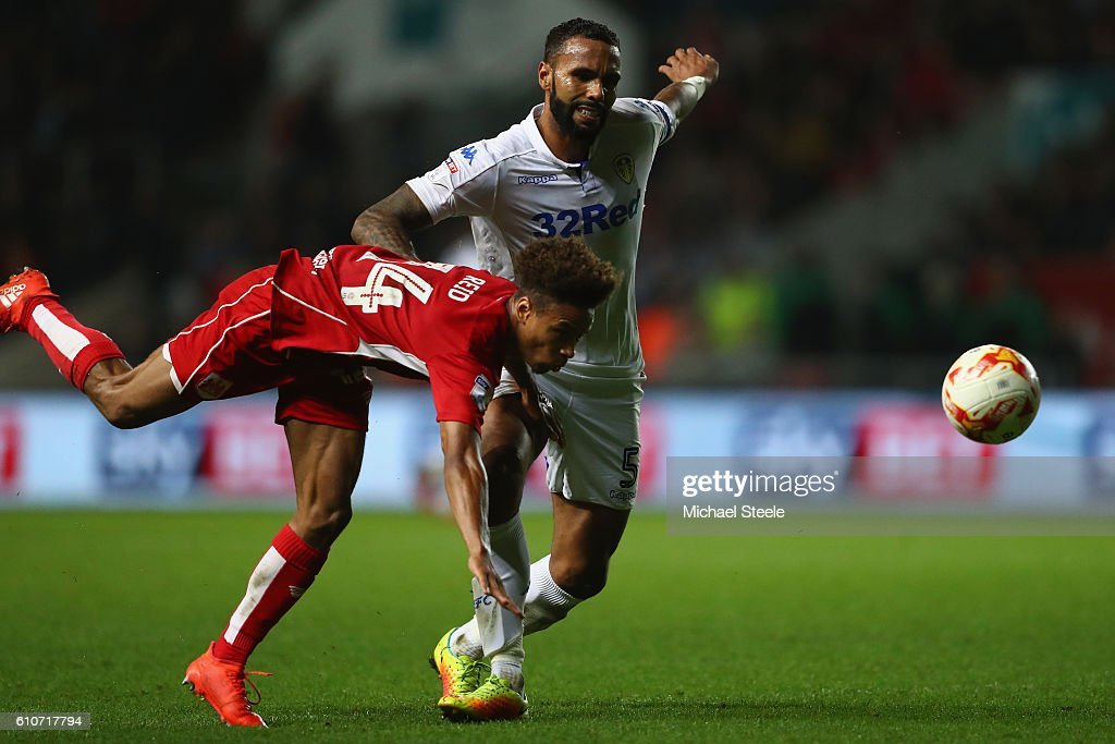 Bobby Reid (L) of Bristol City is challenged by Kyle Bartley of Leeds United during the Sky Bet Championship match between Bristol City and Leeds United at Ashton Gate on September 27, 2016 in Bristol, England.
