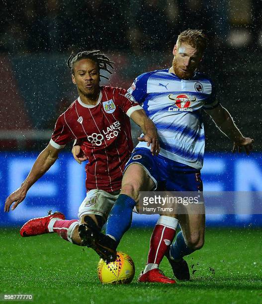Bobby Reid of Bristol City is tackled by Paul McShane of Reading during the Sky Bet Championship match between Bristol City and Reading at Ashton...