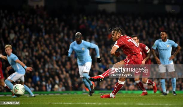 Bobby Reid of Bristol City scores their first goal from the penalty spot during the Carabao Cup SemiFinal First Leg match between Manchester City and...