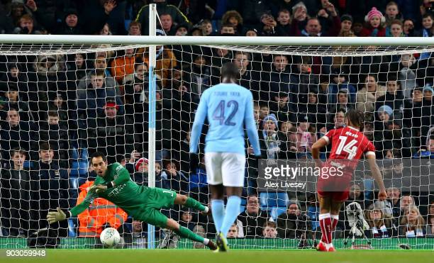 Bobby Reid of Bristol City scores their first goal from the penalty spot past Claudio Bravo of Manchester City during the Carabao Cup SemiFinal First...